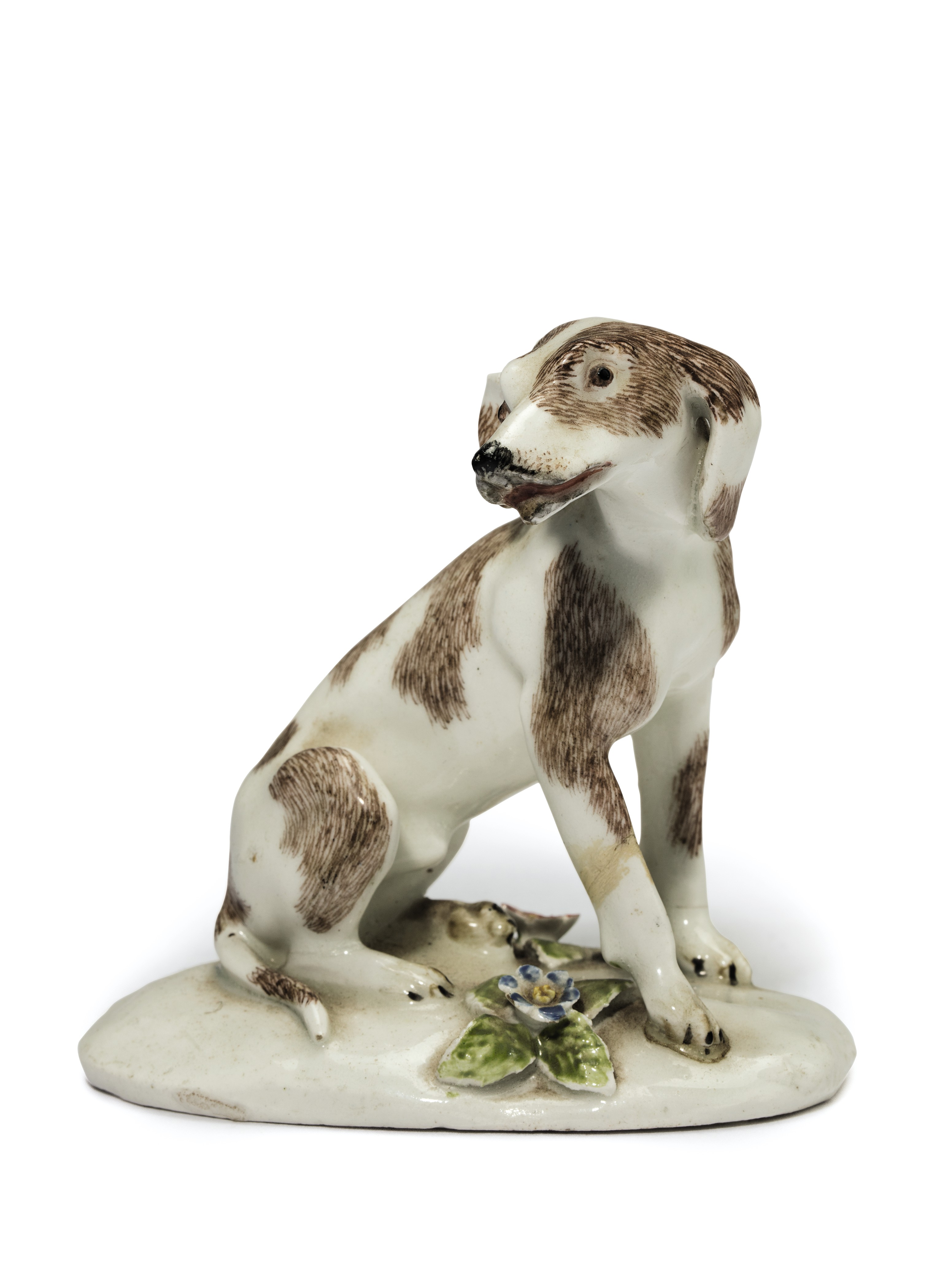 A BOW PORCELAIN MODEL OF A 'DISMAL HOUND'