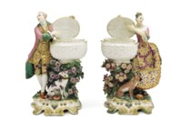 A PAIR OF CHELSEA PORCELAIN FIGURAL SWEETMEAT DISHES