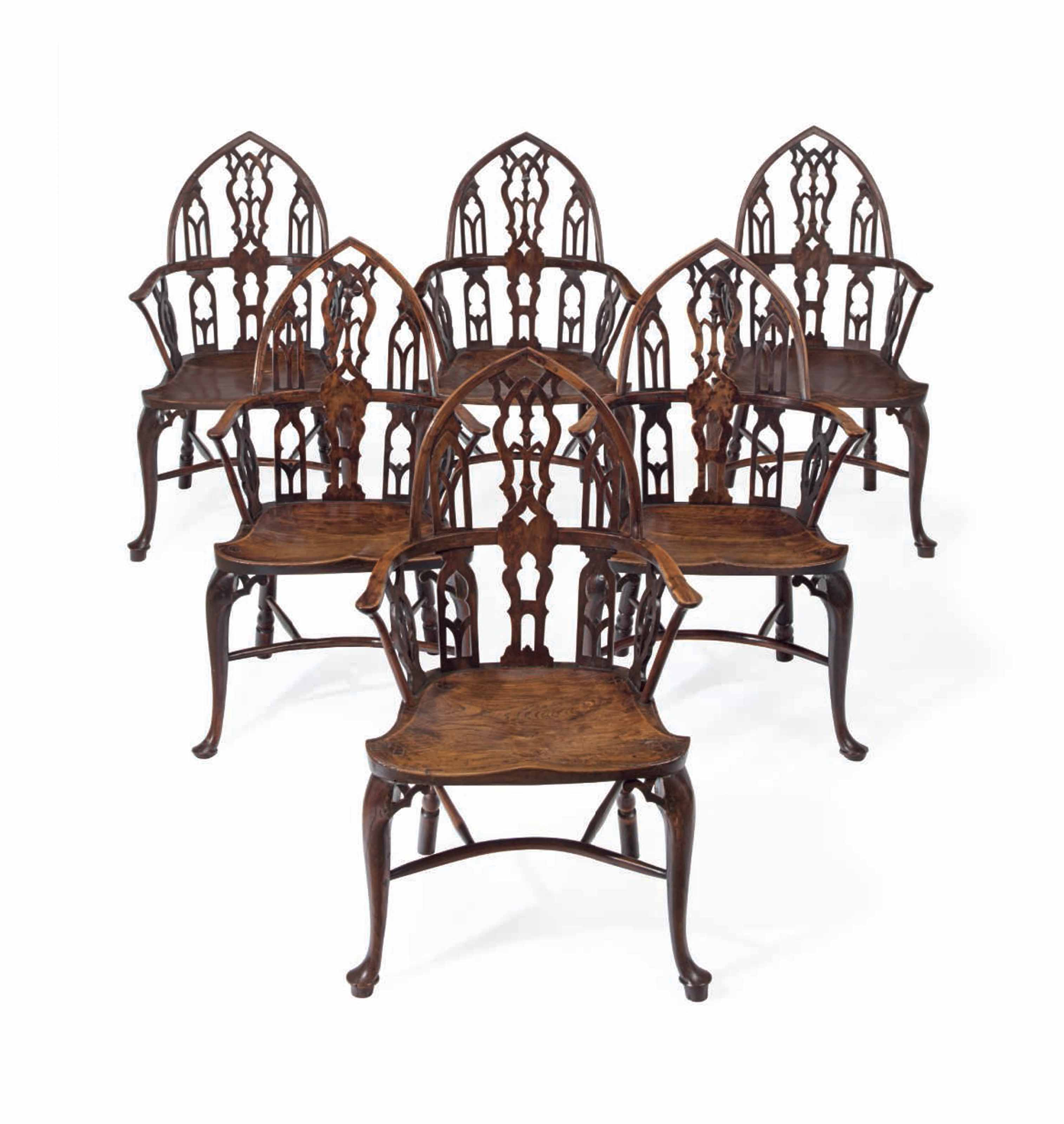 A SET OF SIX GEORGE III YEW AND ELM 'GOTHICK' WINDSOR ARMCHAIRS
