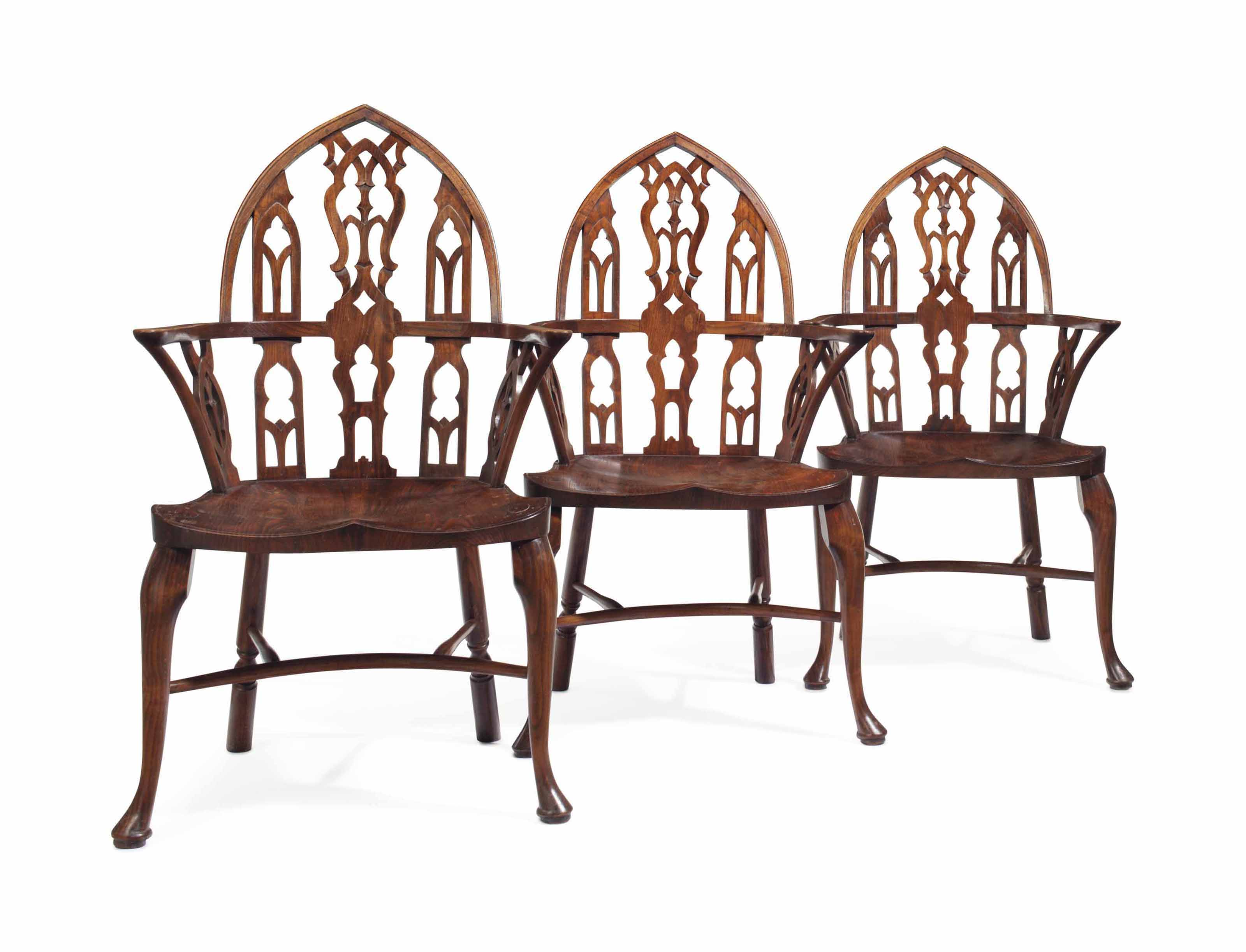 A SET OF THREE GEORGE III-STYLE YEW GOTHIC WINDSOR ARMCHAIRS