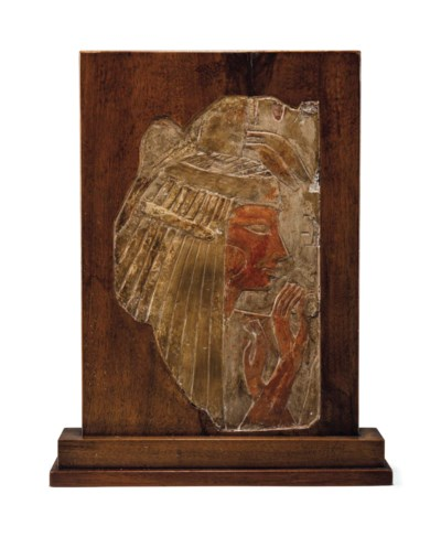 AN EGYPTIAN LIMESTONE RELIEF F