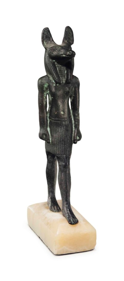 AN EGYPTIAN BRONZE ANUBIS
