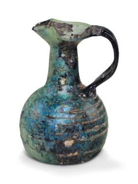 A ROMAN GREEN GLASS OINOCHOE