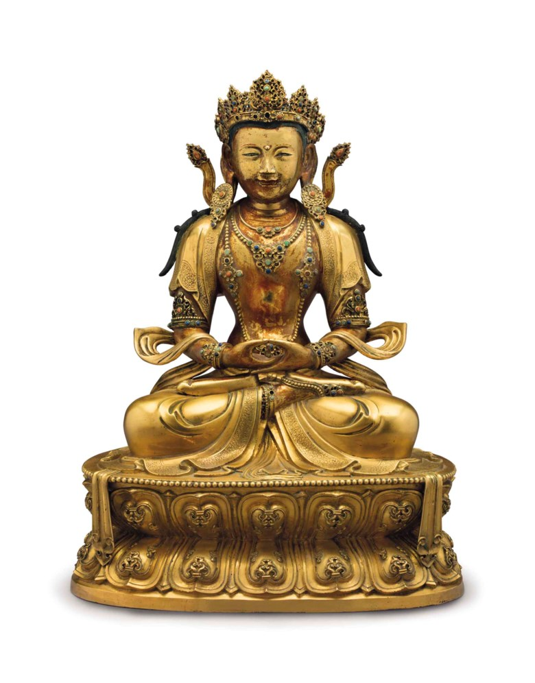An Imperial gilt-bronze figure of Amitayus, China, Kangxi Period (1662-1722). 16 ½  in (41.9  cm) high. Estimate $400,000-600,000. This lot is offered in The Collection of David and Peggy Rockefeller Travel & Americana on 10 May at Christie's in New York