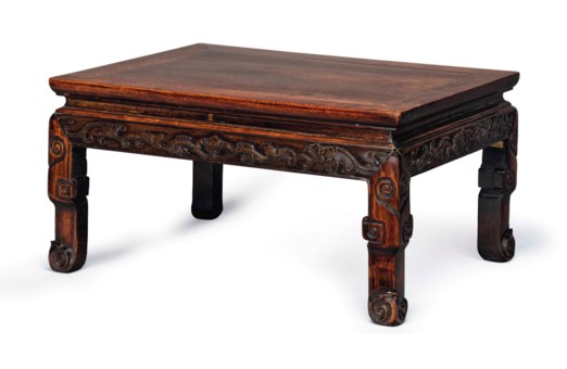 A CARVED HARDWOOD LOW TABLE
