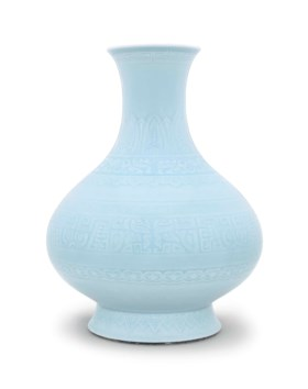 AN UNUSUAL PALE BLUE-GLAZED CARVED PEAR-SHAPED VASE
