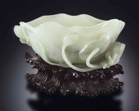 A WHITE JADE 'LOTUS LEAF' BRUSH WASHER
