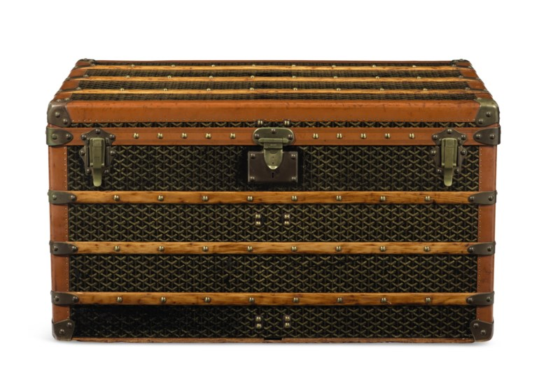 A classic Goyardine canvas steamer trunk with brass hardware, Goyard, 1900s. 100 w x 56 h x 55 d cm. Estimate $8,000-10,000. Offered in What Goes Around Comes Around 25th Anniversary Auction on 18 September 2018 at Christie's in New York