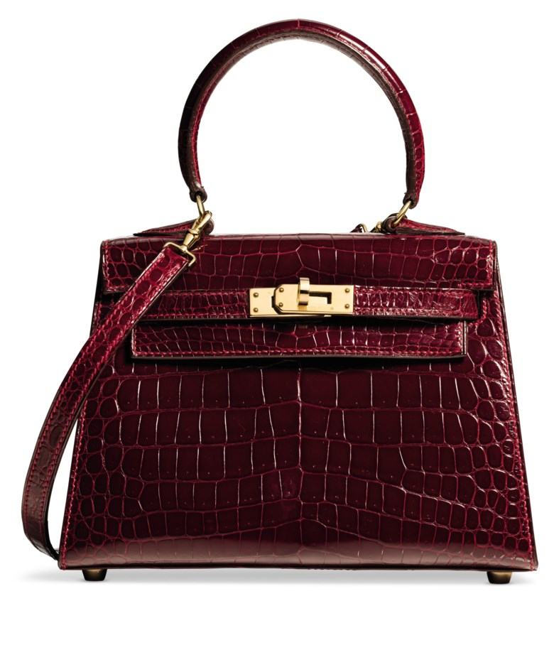 A shiny rouge H porosus crocodile Sellier Mini Kelly 20 with gold hardware, Hermès, 1993. 20 w x 18 h x 14 d cm. Estimate $20,000-30,000. Offered in What Goes Around Comes Around 25th Anniversary Auction on 18 September 2018 at Christie's in New York