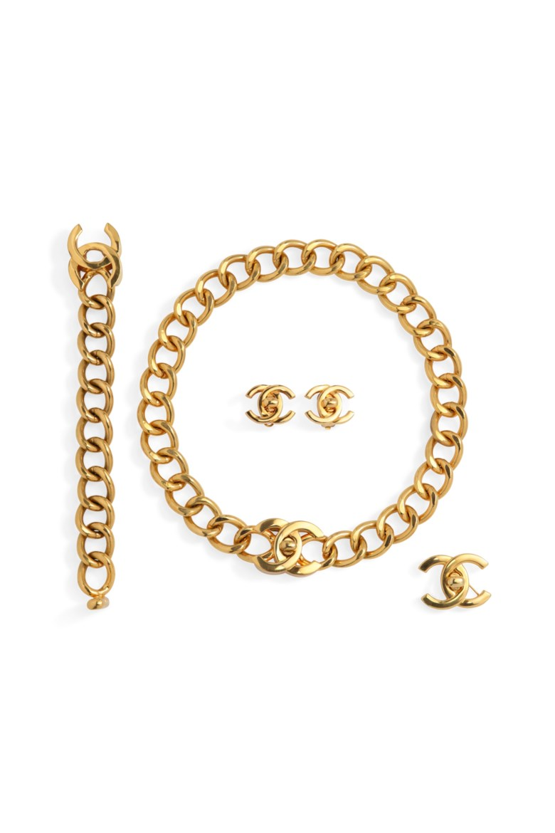 A set of four pieces of gold metal turnlock jewellery, Chanel, springsummer 1997, springsummer 1996, fallwinter 1995. Offered in What Goes Around Comes Around 25th Anniversary Auction on 18 September 2018 at Christie's in New York, and sold for $3,250