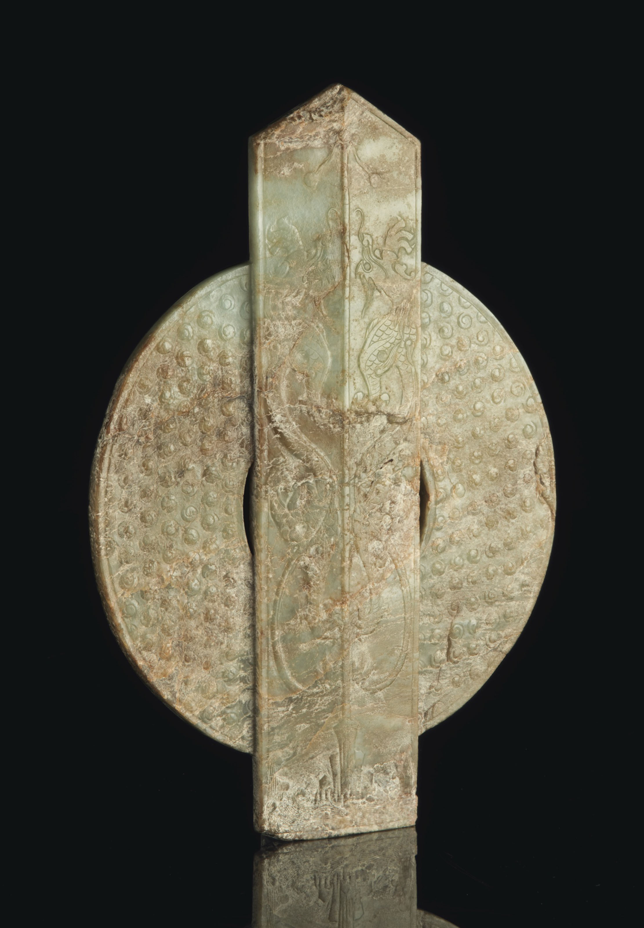 A LARGE PALE GREYISH-GREEN AND MOTTLED PALE BROWN JADE TABLET, GUIBI