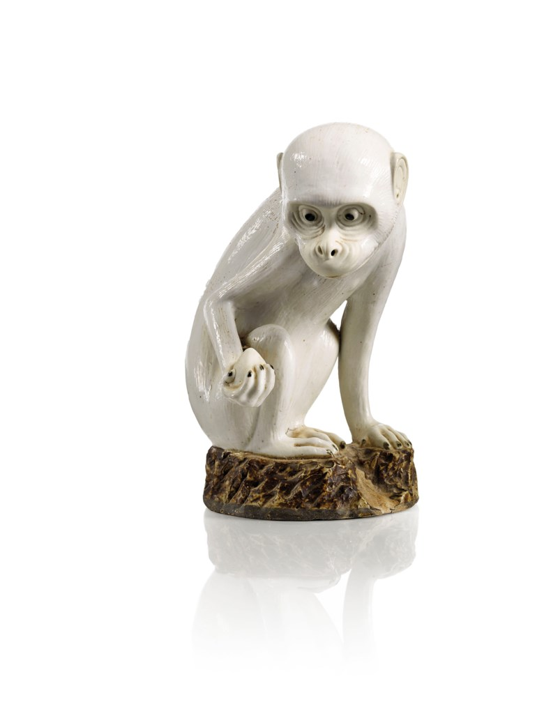 A white and brown-glazed biscuit figure of a monkey, China, Qing dynasty, Qianlong period (1736-1795). Height 22  cm (8¾  in). Sold for €112,500 on 13 June 2018 at Christie's in Paris