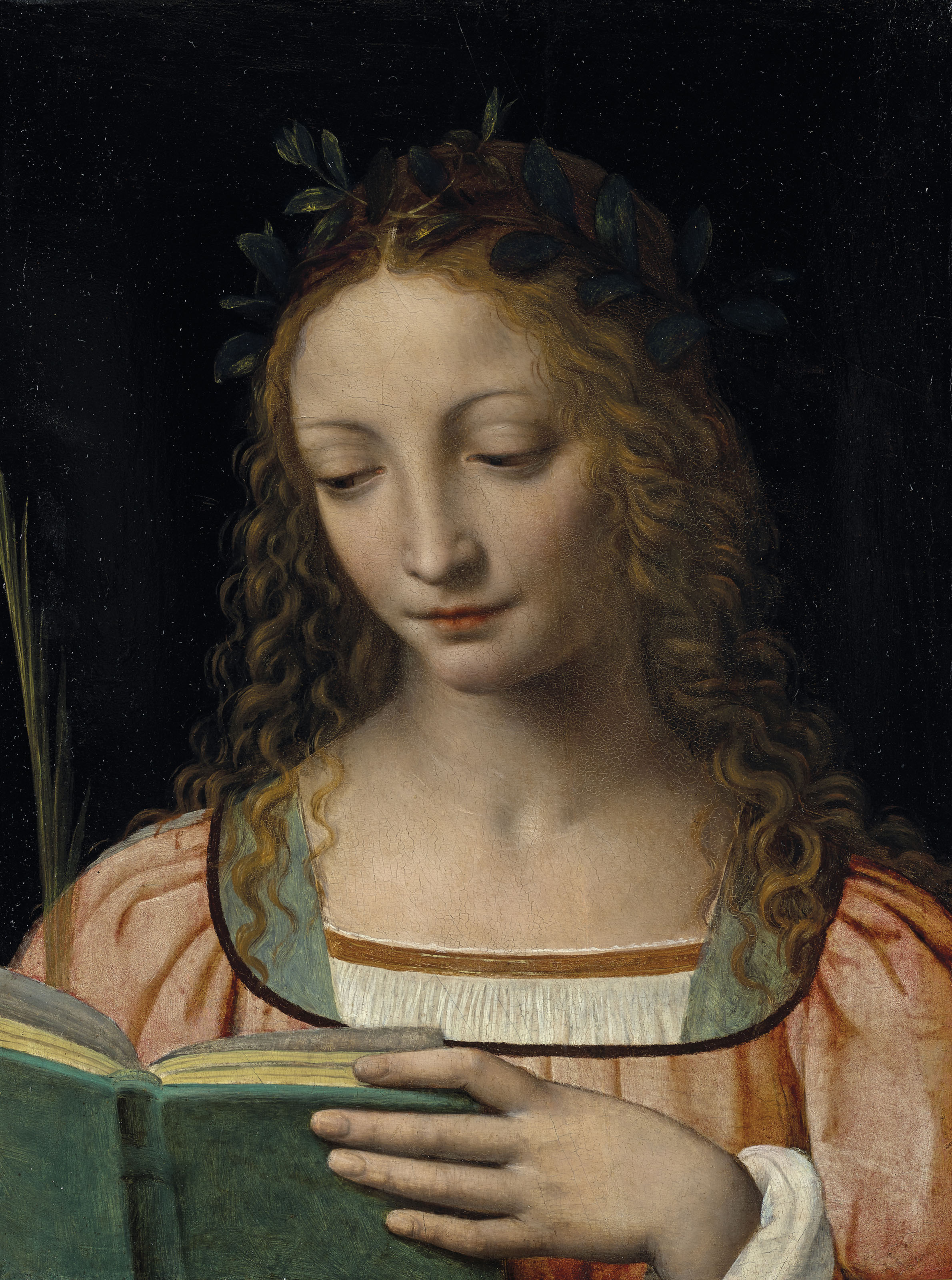 Une figure de sainte, en buste, avec une palme et lisant les Ecritures