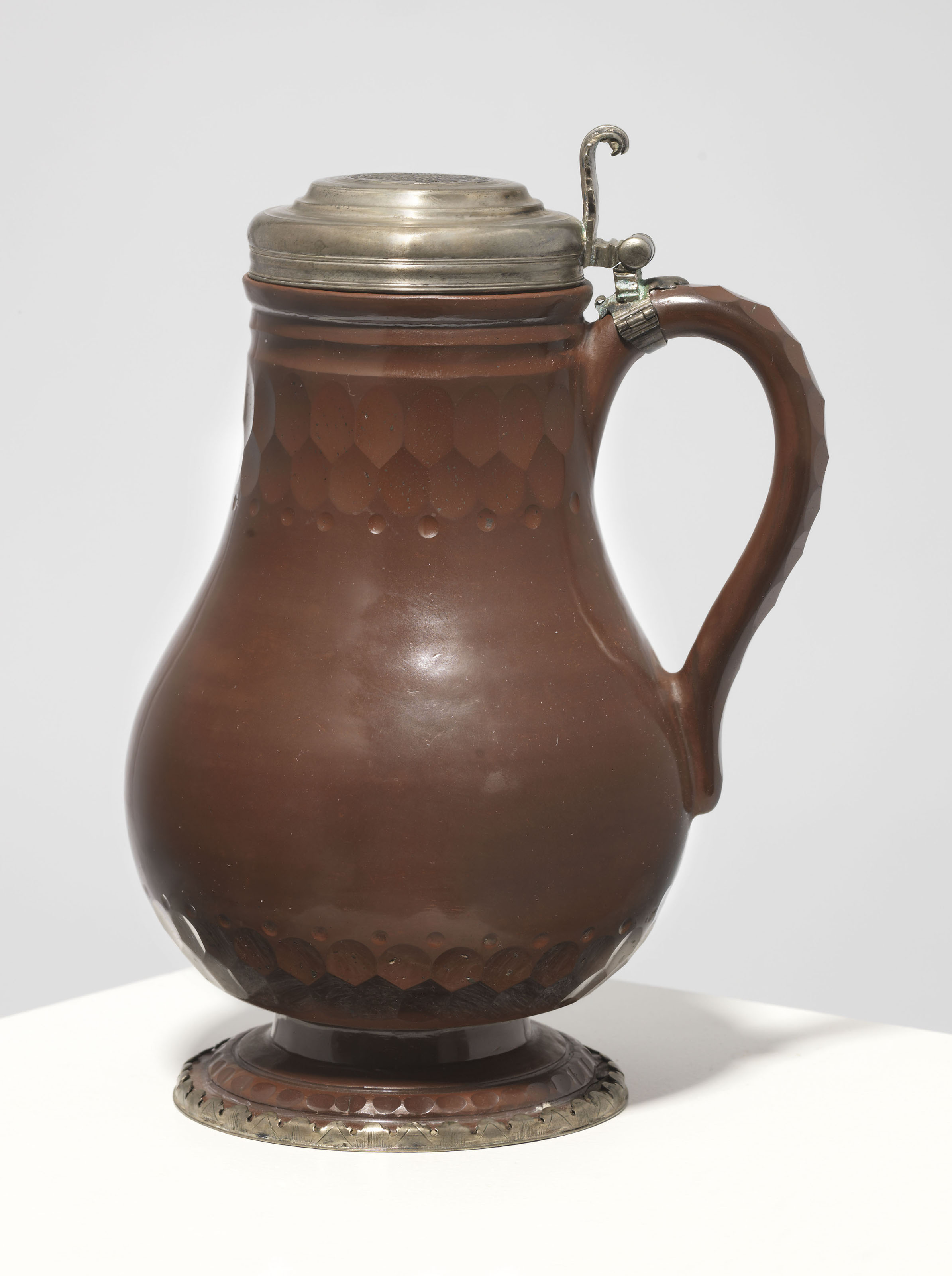 A SILVER-MOUNTED BÖTTGER POLISHED AND CUT RED STONEWARE TANKARD AND COVER