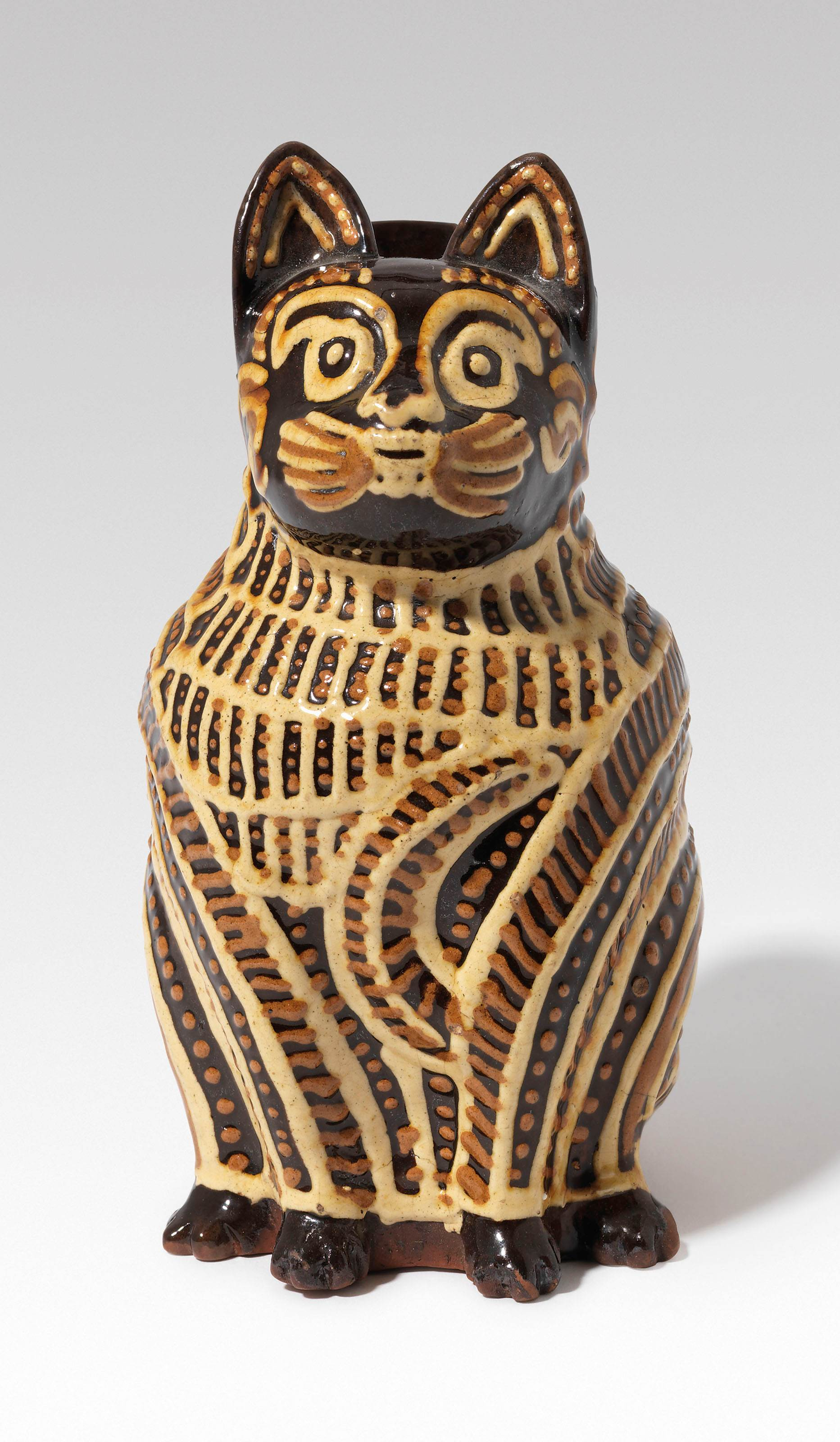 AN ENGLISH SLIPWARE CAT JUG