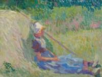 Girl resting against a haystack