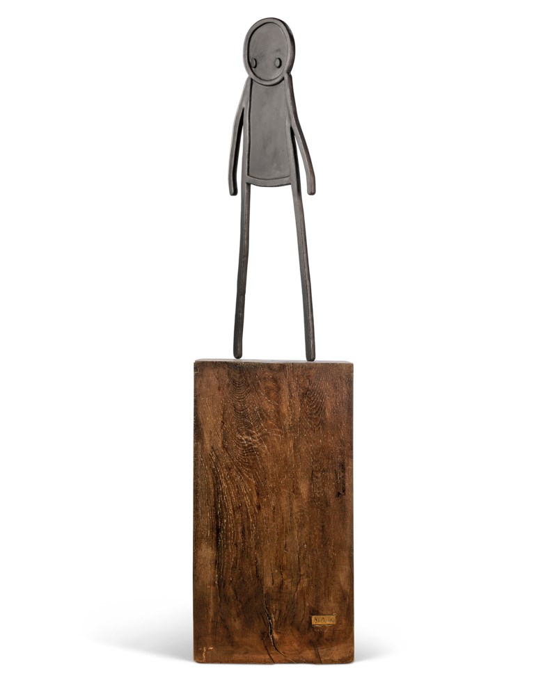 Stik (b. 1979), Heavy, executed in 2012. Sand-cast iron sculpture on the artists oak plinth. 1660 x 410 x 410 mm. (overall). 1660 x 410 x 410  mm (overall). Estimate £100,000-150,000. Offered in Prints & Multiples on 18 September 2019 at Christie's in London