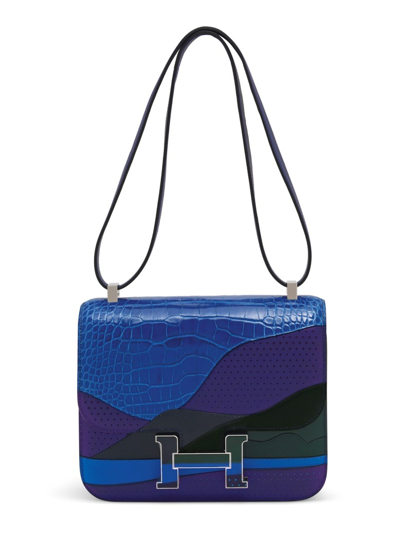 "A limited edition bleu encre, bleu zellige, vert cyprès & bleu nuit, shiny alligator & niloticus lizard ""Au Bout Du Monde"" Constance 24 with palladium hardware, Hermès, 2018. 24 w x 19 h x 7 d cm. Sold for £35,000 on 11 June 2019 at Christie's in London"