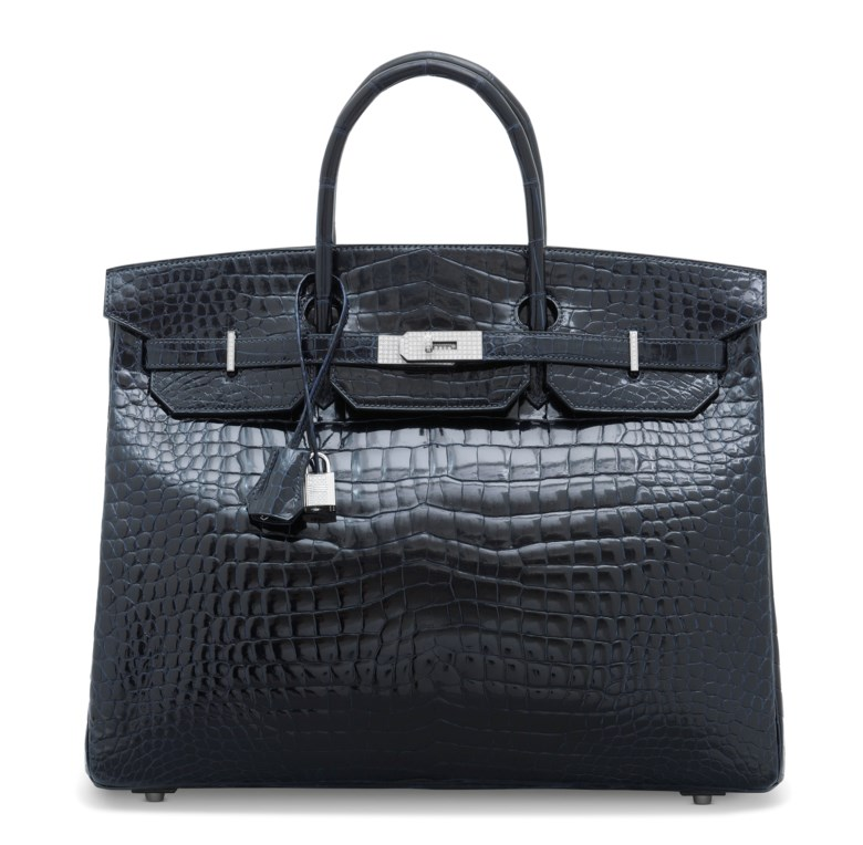 An exceptional, shiny Bleu Marine porosus crocodile Birkin 40 with 18k white gold & diamond hardware, Hermès, 2012. 40 w x 32 h x 20 d cm. Sold for £87,500 on 11 June 2019 at Christie's in London