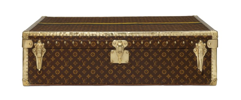 A monogram canvas brass bound motoring trunk, Louis Vuitton, 1910s. 89 w x 25 h x 20 d cm. Sold for £10,000 on 11 June 2019 at Christie's in London
