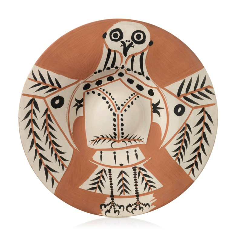 Pablo Picasso (1881-1973), Hibou blanc sur fond rouge (A.R. 395), conceived on 25 march 1957 and executed in a numbered edition of 200. Terracotta plate, partially engraved, with coloured engobe. Diameter 17½ in (44.5 cm). Estimate £12,000-18,000. Offered in Picasso Ceramics Online, 13-20 June 2019