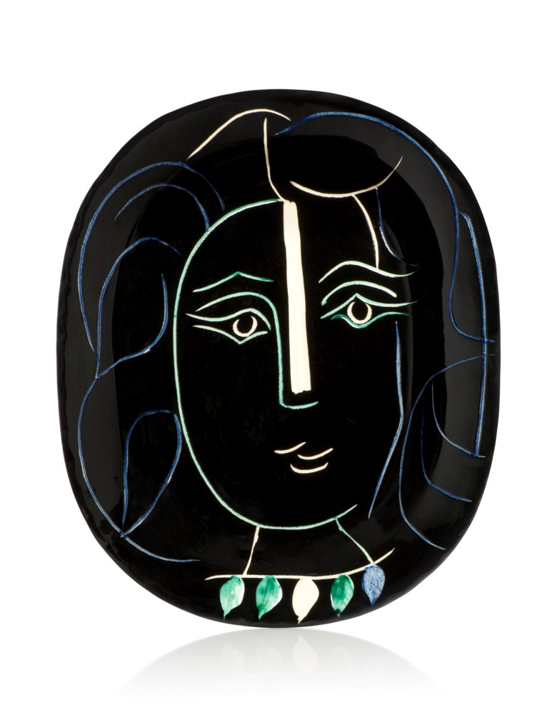 Pablo Picasso (1881-1973), Visage de femme (A.R. 220), 1953. Executed in an edition of 400. White earthenware ceramic plate, with coloured engobe and glaze. Length 15¼ in (38.7 cm). Estimate £15,000-25,000. Offered in Picasso Ceramics Online, 13-20 June 2019