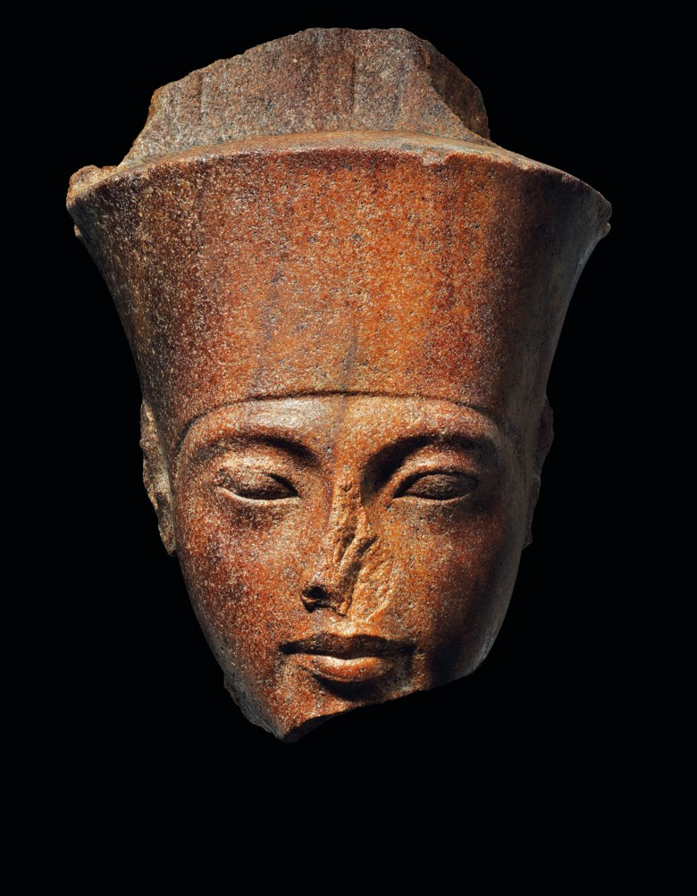 An Egyptian brown quartzite head of the god Amen with the features of the Pharaoh Tutankhamen, New Kingdom, 18th dynasty, reign of Tutankhamen, circa 1333-1323 BC. 11¼  in (28.5  cm) high. Sold for £4,746,250 in The Exceptional Sale on 4 July 2019 at Christie's in London