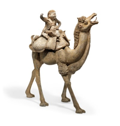 A MASSIVE PAINTED POTTERY FIGURE OF A CAMEL AND RIDER