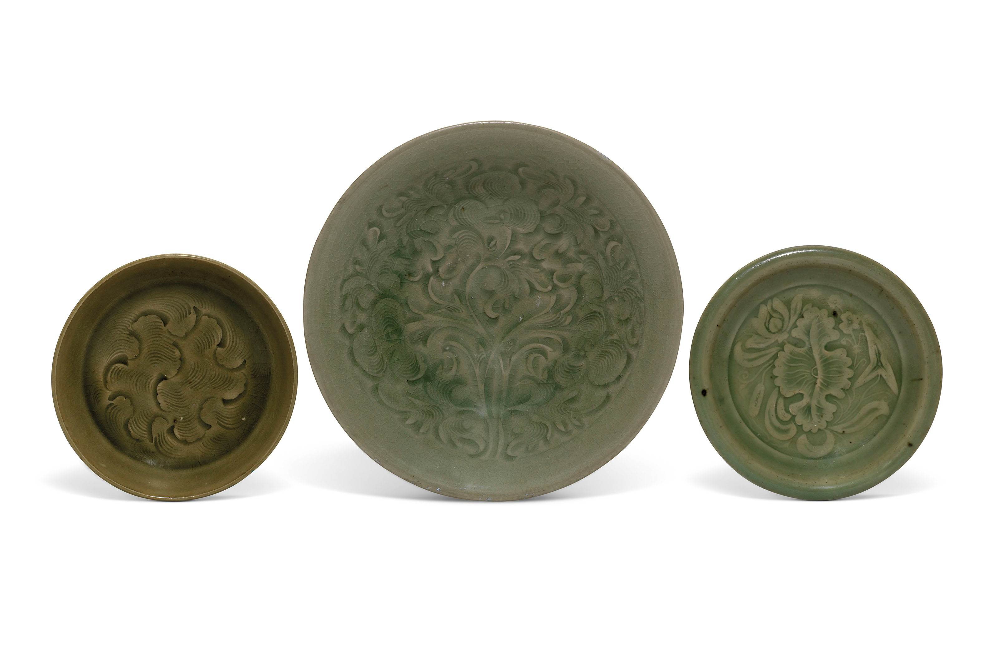 A CARVED YAOZHOU CELADON BOWL AND A YAOZHOU DISH AND A CARVED...