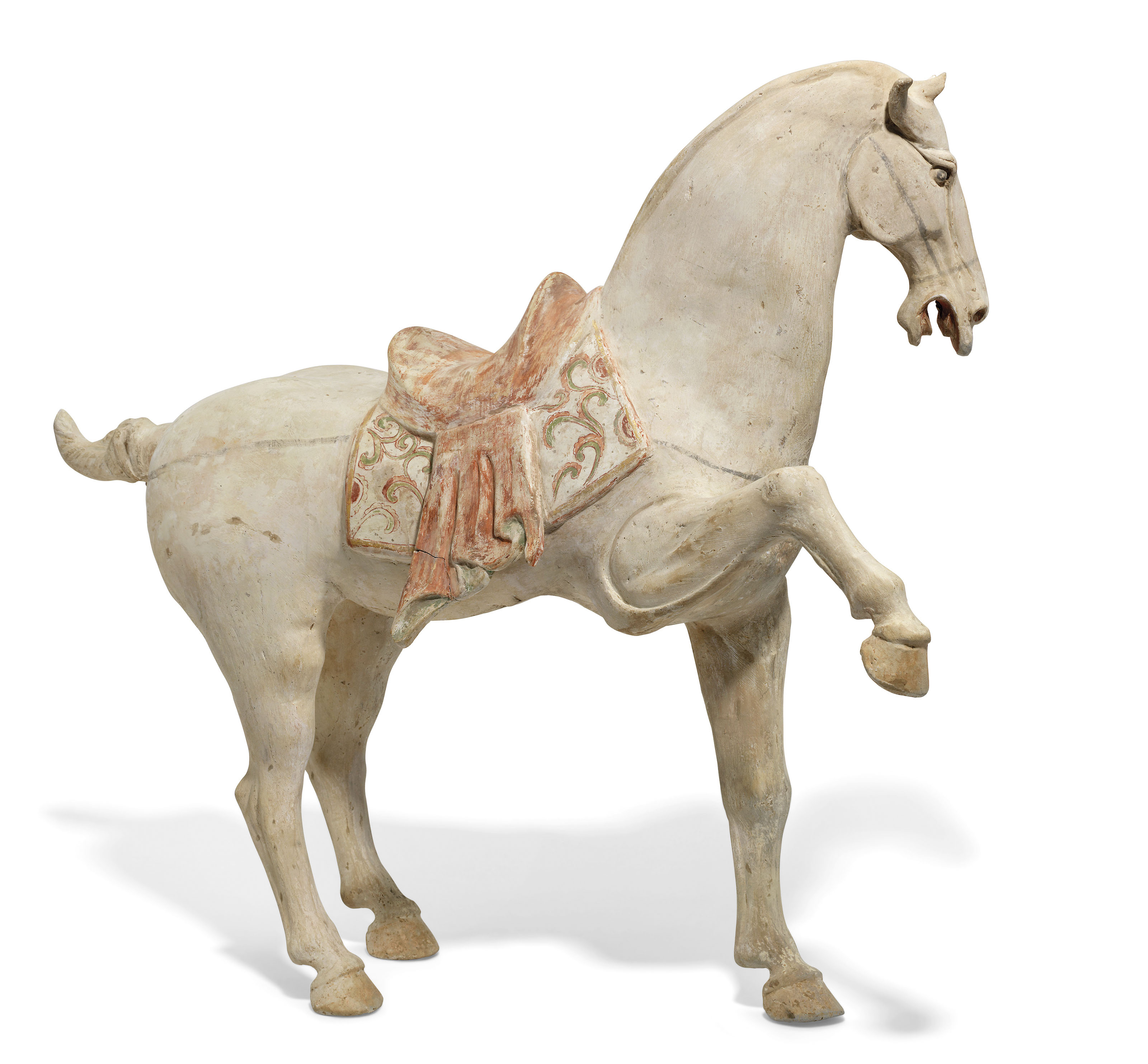A LARGE PAINTED POTTERY FIGURE OF A PRANCING HORSE