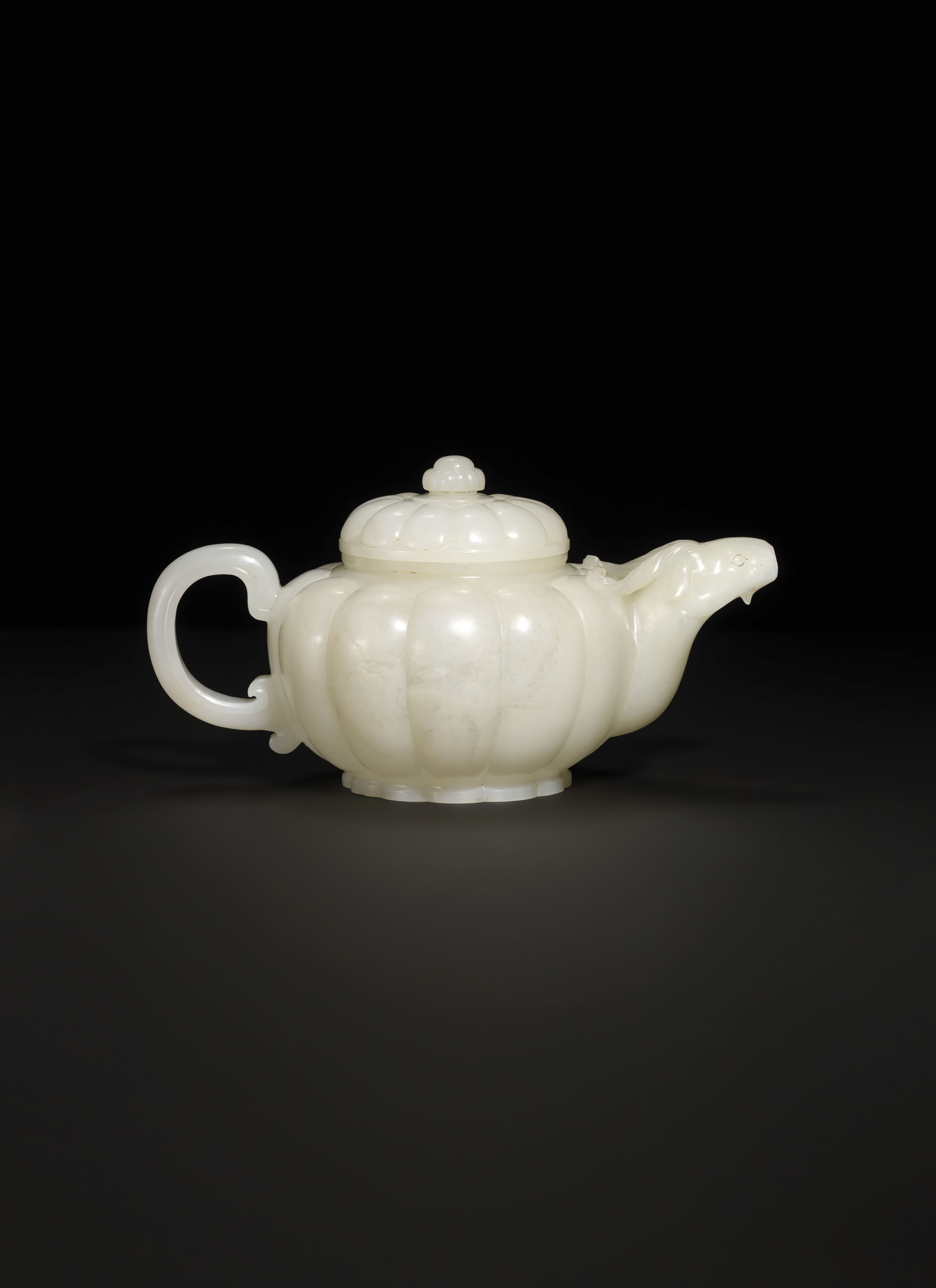 A WHITE JADE 'RAM' LOBED TEAPOT AND COVER