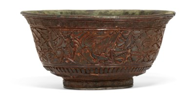 A RARE CARVED RED AND BLACK LACQUER 'PHOENIX' BOWL