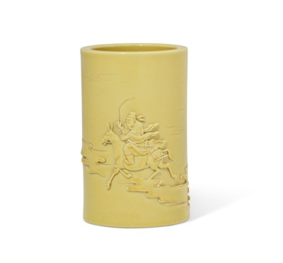 A CARVED YELLOW-GLAZED 'FIGURAL' BRUSH POT, BITONG