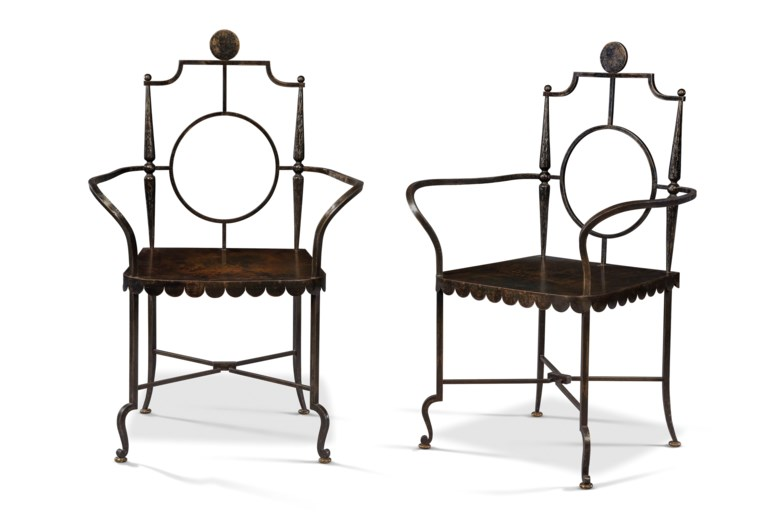 A pair of French patinated-bronze armchairs, after the 1943 model by Gilbert Poillerat (1902-1988), second half 20th century. 40½  in (103  cm) high; 26  in (66  cm) wide; 17¾  in (45  cm) deep. Estimate £4,000-6,000. Offered in Interiors Including Posters on 11 September 2019 at Christie's in London