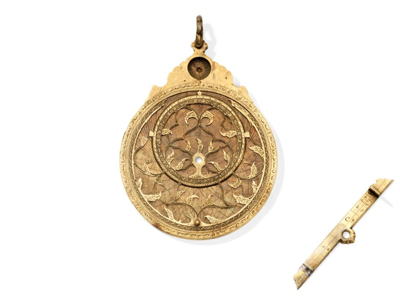 A fine Safavid brass astrolabe, signed Muhammad Zaman al-Munajim al-Mashhadi al-Asturlabi, Mashhad, Iran, 17th century. 6⅞ in (18 cm) high overall; 5⅜ in (14 cm)  diam. Estimate £100,000-150,000. Offered in Art of the Islamic and Indian Worlds Including Oriental Rugs and Carpets on 2 May 2019 at Christie's in London