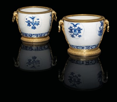 A NEAR PAIR OF FRENCH ORMOLU-MOUNTED CHINESE PORCELAIN CACHE-POTS