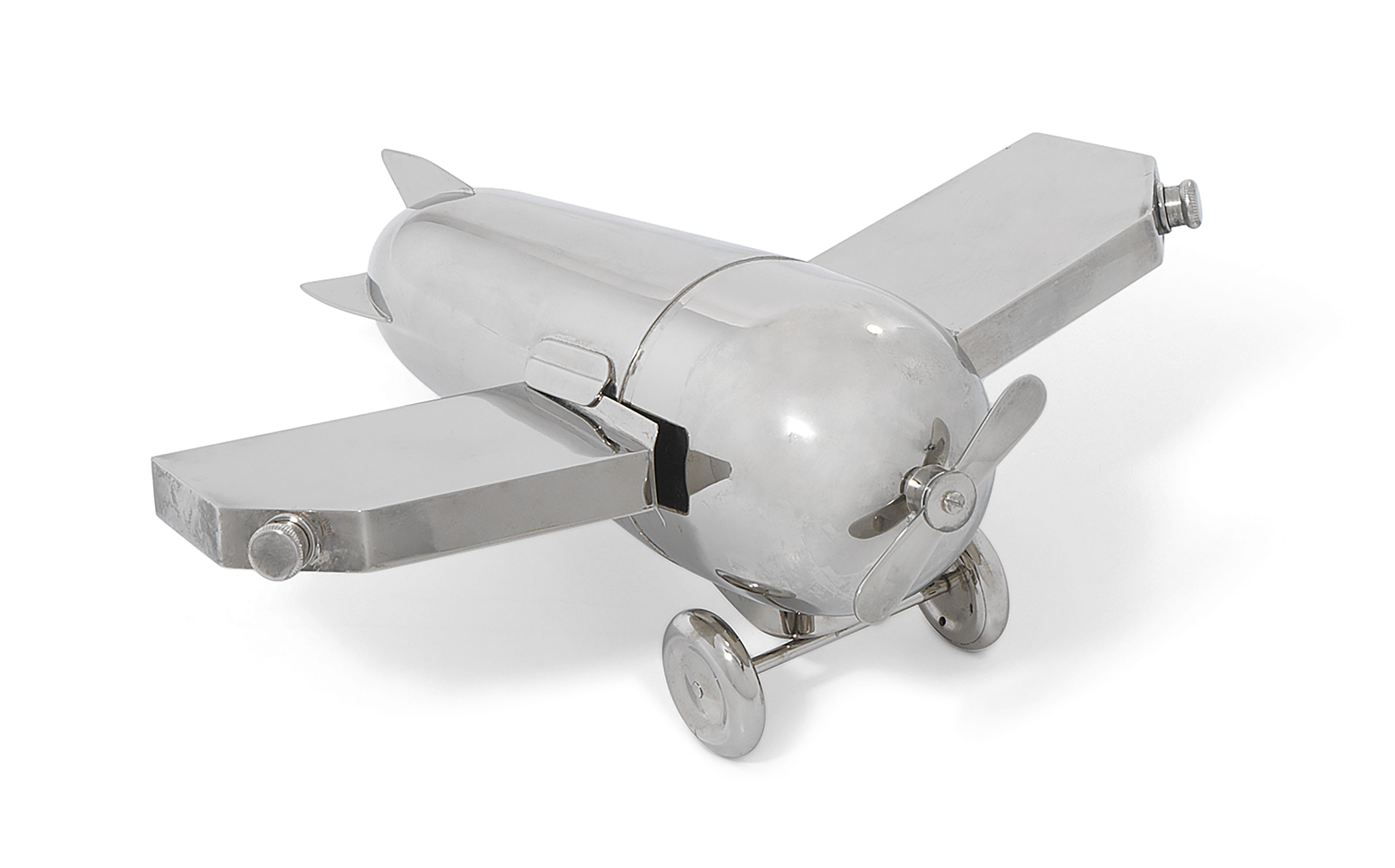 A German silver-plated novelty cocktail shaker in the form of a monoplane, mark of J.A. Henckels, first half 20th century. 9⅞  in (25  cm) long. Estimate £3,000-5,000. This lot is offered in The Collector Silver and 19th Century Furniture, Sculpture, Ceramics & Works of Art on 14 November 2019 at Christie's in London