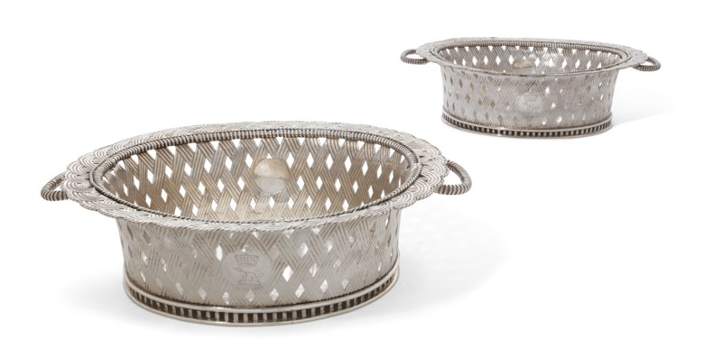 A pair of George II silver baskets, maker's mark of Anthony Nelme only, London, circa 1730. 14¾  in (37.7  cm) long. Estimate £20,000-30,000. Offered in The Collector Silver and 19th Century Furniture, Sculpture, Ceramics & Works of Art on 14 November 2019 at Christie's in London