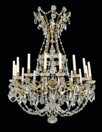A PAIR OF FRENCH ORMOLU AND MOULDED-GLASS SIXTEEN-LIGHT CHANDELIERS