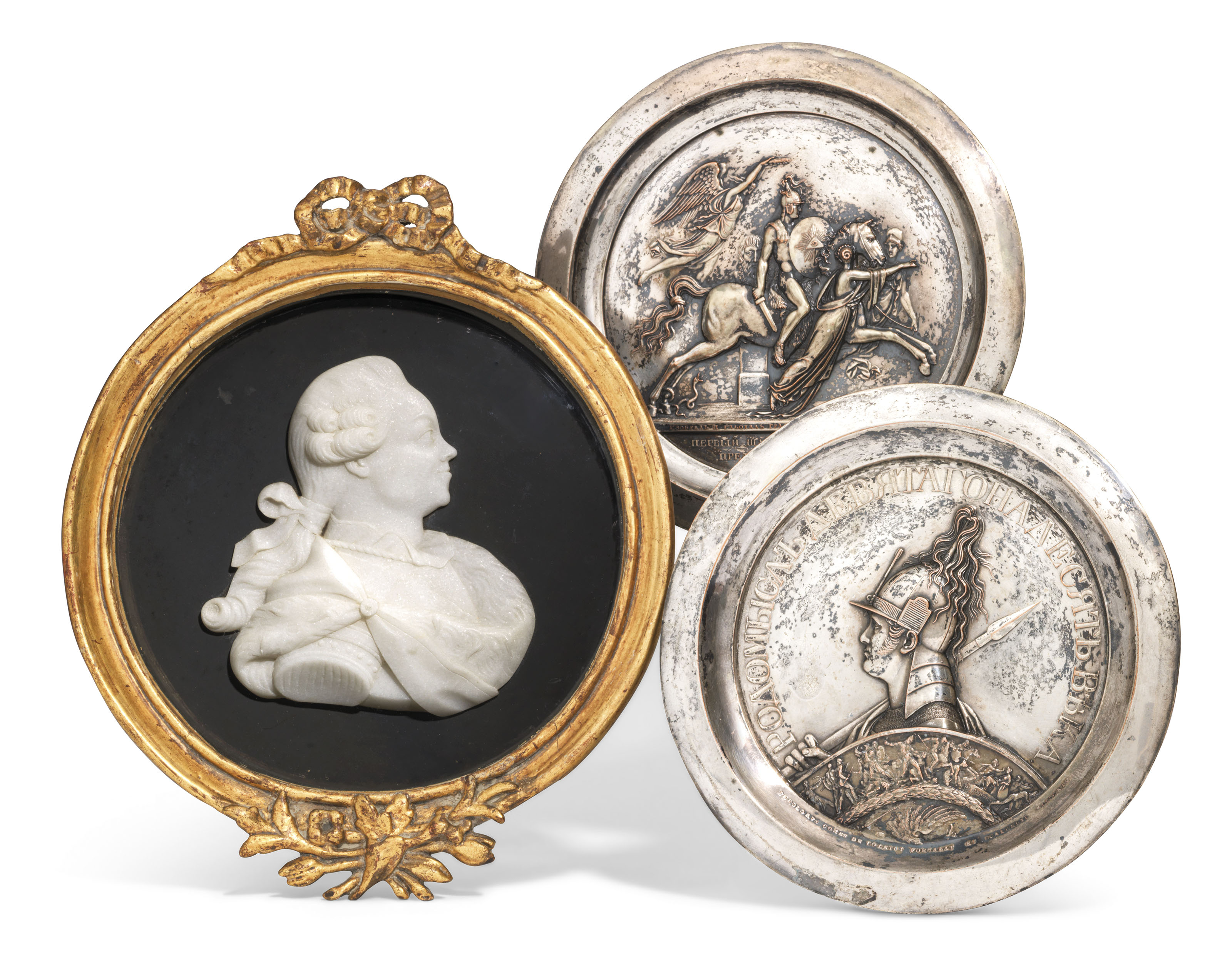 A MARBLE CAMEO AND TWO METAL PLAQUES