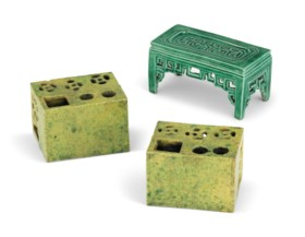 A PAIR OF YELLOWISH-GREEN-GLAZED INCENSE HOLDERS AND A GREEN