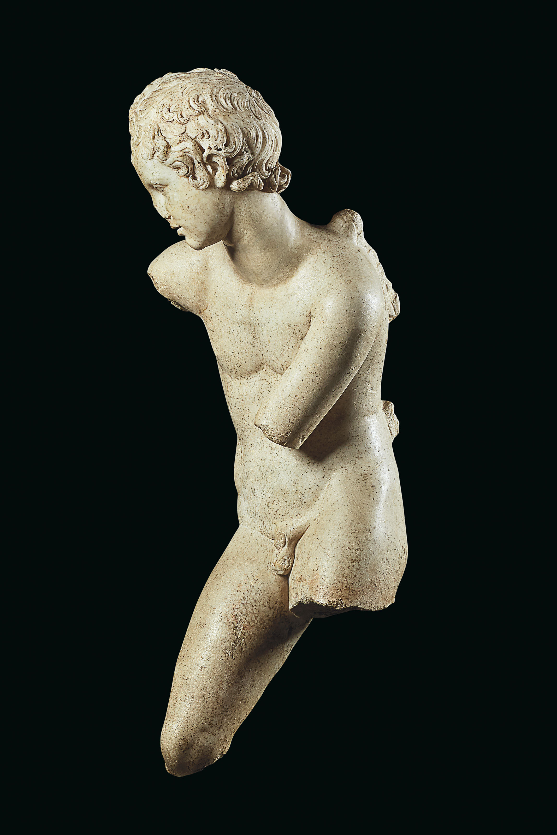 A ROMAN MARBLE EROS UNSTRINGING HIS BOW