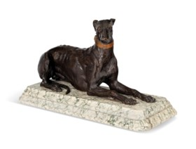 A FRENCH PATINATED BRONZE MODEL OF A RECUMBENT GREYHOUND