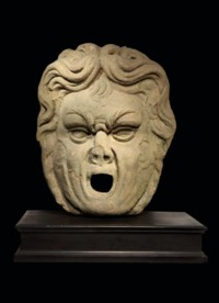 AN ITALIAN STONE FOUNTAIN MASK
