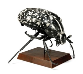 A POLYCHROME-DECORATED PLASTIC DIDACTIC MODEL OF A BEETLE