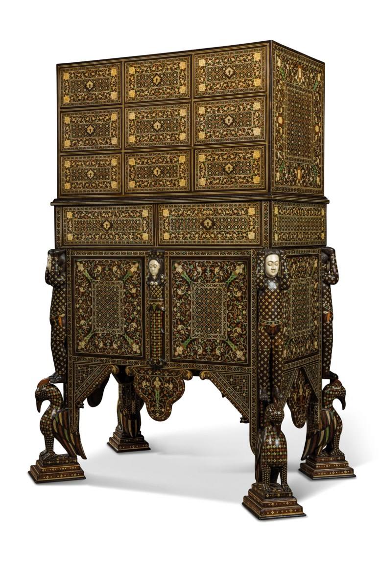 A royal Indo-Portuguese ivory-inlaid Indian rosewood and padouk cabinet-on-stand (contador), late 17th century, Goa. 56½  in (143.5  cm) high; 35½  in (90  cm) wide; 36¼  in (92  cm) deep. Estimate £70,000-100,000. Offered in Peter Petrou Tales of the Unexpected on 30 January 2019 at Christie's in London