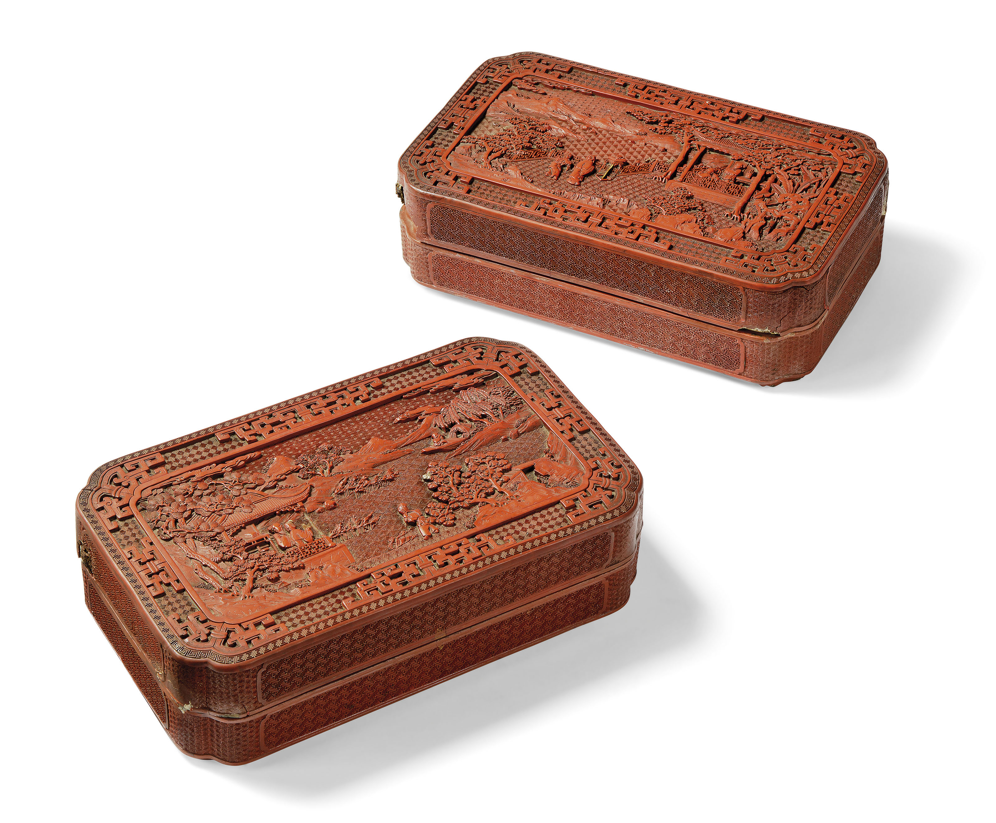 A FINELY CARVED PAIR OF CHINESE CINNABAR LACQUER BOXES AND COVERS