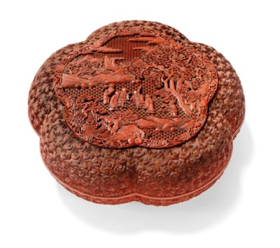 A FINELY CARVED LOBED CINNABAR LACQUER BOX AND COVER