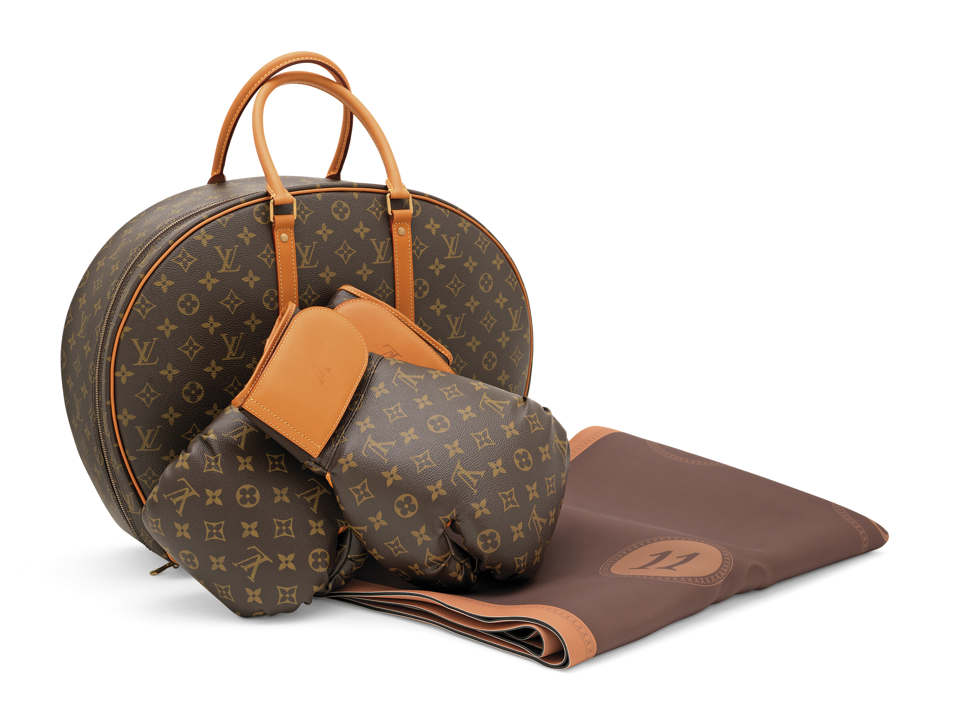 A LIMITED EDITION MONOGRAM CANVAS ICONOCLAST SET OF BOXING GLOVES, MAT & CASE BY KARL LAGERFELD