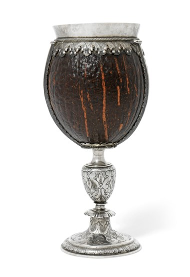 A James I silver-mounted coconut cup,circa 1600-1620. 8¾  in (22  cm) high. Estimate £15,000-25,000. Offered in The David Little Collection of Early English Silver on 3 December 2019 at Christie's in London